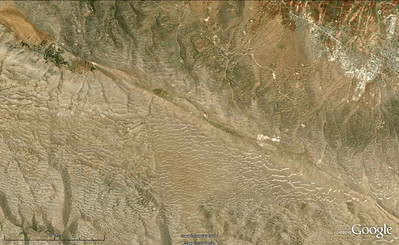 WoGE #220  After losing track of the WoGE series for months, I managed to find the latest challenge and locate Ron's WoGE#219 in northern Peru easily, but had a hard time squeezing out relevant geological information about it, in spite of a nearly full access to the geological literature. At the end, I'm still frustrated because I have no faint idea what those nice dikes are, what's their age and source, and what major tectonic process generated the extensional faults they intruded.  OK, it's my turn now to post a new quiz, and I figured that this sandy spot deserves being highlighted in WoGE. Once located, I guess it becomes pretty obvious why. So, to win this round, one must be the first to provide latitude and longitude of this place, and describe in a few words its main geological attraction.  This is a fairly easy quiz, thus I'll invoke the infamous Schott Rule meant to frustrate WoGE pros by preventing them to post answers before a number of hours equal to the number of their wins expires.   Posting time is 6:25 pm GMT, Monday, Nov. 8,