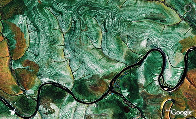 WoGE #124  I found Ron's WoGE #123 in South Africa, so I'm pleased to serve the WoGE community with the next challenge, again from the geo-art category. If the scale bar would be in centimeters, one quickly could answer: it's a nice piece of malachite. But the scale is in kilometers, so I wonder who will be the first to identify this handsome feature, and provide some useful geological description. This is another Schott's rule-free run, folks, so you better stay tuned.