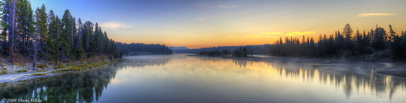 Sunrise from Fishing Bridge. The extra orange/brown tint comes from residual smoke from the Arnica Creek fire just south of here. This is a panorama composed from 9 HDR images (3 exposures each for a total of 27 shots).