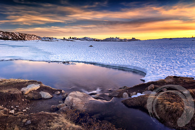 Middle Gaylor Lake at sunset.  After the bristlecones, we headed north to the Tioga Pass area.  The lake was mostly frozen over.  In an attempt to get some interesting foreground, I lay on my stomach free some of the frozen shoreline.  On my 2nd attempt, it collapsed under my legs and I fell in, getting soaked up to my knees!  I got the message & stopped trying to mess with Mother Nature then.