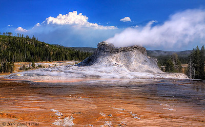 Castle geyser in the Upper Geyser basin. Smoke from the Arnica Creek fire can be seen in the background.
