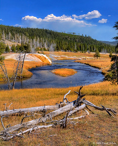 Along the Firehole River in the Upper Geyser Basin. Smoke from the Arnica Creek forest fire is in the background.