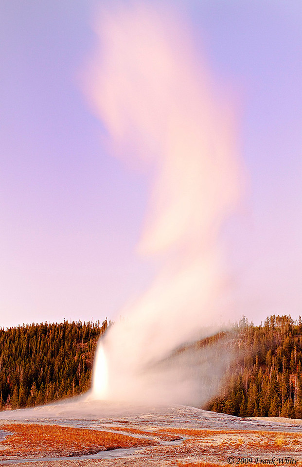 Old Faithful at sunset. I used a 3 second exposure to capture the wind-whipped wispy steam.