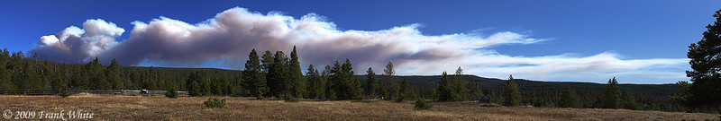 Smoke from the Arnica Creek fire stretched across 1/2 of the southern sky on this very windy afternoon. Taken from the Upper Geyser Basin area. Stitched Panorama of 9 shots.