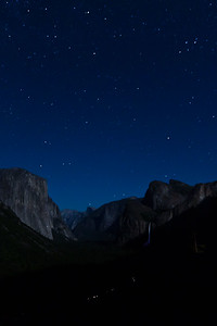 Moonlit scene from Tunnel View of El Capitan, Half Dome and Bridalveil Falls. Note lights on the face of El Capitan (camping rock climbers) and cars.