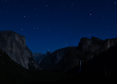 Moonlit scene from Tunnel View of El Capitan, Half Dome and Bridalveil Falls. Note lights on the face of El Capitan (camping rock climbers).