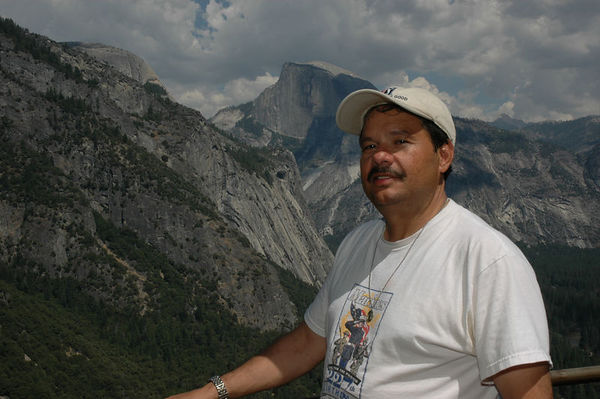 Peter Padilla halfway point of Upper Yosemite Falls Trail w/ Half Dome in Background