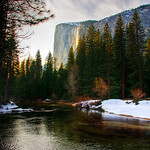 Another view of Horsetail Falls at Sunset in Yosemite National Park.  This image is taken further back across the Merced River on the bank.   Horsetail Falls at Sunset in Yosemite National Park has is quite the phenomenon and amazing effect!