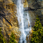 """""""Light on Yosemite Falls"""" A small section of Yosemite Falls with a little glow on the rock face. I love the textures and colors that you can see in the rock along Yosemite Falls. Almost a painting in nature. This is from Spring 2014 when the falls were doing quite a bit better. Nothing better than hanging out with the family in Yosemite in the Spring! Who is going this year?!"""