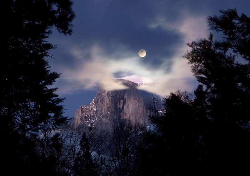 """Full Moon over Half Dome""  Yosemite in Winter.  This was my 'consolation' shot while trying to capture my ""Nature's Firefalls"" rare image of Horsetail falls at sunset.   I wish that I could say that I had fully researched this shot and was ready for it.  Instead, I was coming back from another failed attempt to capture my Nature's Firefalls image.  When I came around the corner, the moon was sitting there!!  I stopped my car, setup my tripod in the middle of the road (please don't tell the park rangers I did that as it isn't a good idea!)  I captured 4 shots before the moon and Half Dome were totally obscured by the clouds!  I was pretty lucky to capture this - but that is part of photography.  See my Nature's Firefalls image here:  http://www.jharrisonphoto.com/gallery/2747559_ghkMc/1/281579766_t4hmN/Medium  I am debuting this week my latest images from my award winning trip to Yosemite.   <a href=""http://www.jharrisonphoto.com/gallery/7554507_MVWMR""target=""_blank"">My Yosemite can be seen here.</a>   Let me know which ones you like!  Thanks, John"