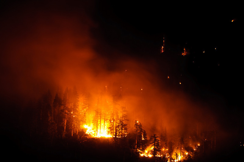 """Images from the Grouse Fire in Yosemite.  I shot this from Glacier Point Road and it shows some of the flames and smoke clearly still going.  It is being managed and more information can be found here on the NPS website.  <a href=""""http://www.nps.gov/yose/parkmgmt/current_fire.htm"""">http://www.nps.gov/yose/parkmgmt/current_fire.htm</a><br /> This was shot Friday, June 26 in the evening, so I assume it looks even bigger now."""