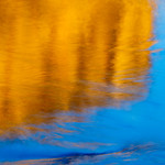 """""""Reflections of El Capitan at Sunset"""" Yosemite National Park.  The sunlit El Capitan at Sunset on the Merced.   <br /> <br /> I am excited to announce that my """"Reflections of El Capitan at Sunset"""" has been accepted into a prestigious gallery exhibit in Yosemite! No, not the Ansel Adams gallery (not yet!), but an exhibit called the """"Yosemite Renaissance"""" This was one of my major goals this past year and I got in!<br /> <br /> The sunlit El Capitan at sunset is reflected on the Merced. I shot this during my national contest winning trip last year (I won the Aperture Nature Photography contest) where I got to shoot with 4 professionals including Scott Bourne, Jennifer Wu, Steve Simon and Gary Hamburgh.<br /> <br /> If you are in Yosemite in the next few months, stop in and visit the exhibit at the Yosemite Museum Gallery through May 2nd. There is also a reception this Friday, Feb 26th that I will be attending if you are close by!<br /> <br /> If you would like one of these limited edition images, they are for sale. I am offering special discount pricing for the Gallery wrap canvas images:<br /> 16"""" x 24"""" is $225<br /> Send me a message or email to arrange to purchase. Framed images are also available. Reserve your early editions now!<br /> <br /> The Yosemite Renaissance is in its 25th year and showcases different views capturing the spirit of Yosemite in different art mediums. This competition and juried exhibit is open to professional and amateur artists and they had a record number of entries this year. Only a few photographers were accepted. Some other famous Yosemite photographers that have exhibited there include Charlie Cramer, Michael Frye (both of whom I have studied under), William Neill and Elizabeth Carmel.<br /> <br /> About the image:<br /> Blue skies are normally not too interesting, so I looked around to find a smaller, more interesting composition. The reflected orange glow from El Cap just lit up the Merced and I found this soothing image (this is one"""