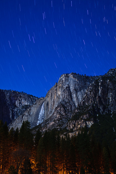 """Star Trails over Yosemite Falls.  Yosemite National Park.  I shot this in January during my Aperture Nature Photography contest winning trip at about 4am in the Ahwahnee meadow standing in about 2 feet of snow.  This is about a 10 minute exposure.  The light below is from the buildings and cabins below.  Standing in all that snow my feet were COLD!!   See more images from my """"Water, Light and Textures"""" series I shot during the Aperture Nature Photography Workshop contest here:  <a href=""""http://www.jharrisonphoto.com/gallery/7554507_MVWMR"""">http://www.jharrisonphoto.com/gallery/7554507_MVWMR</a>"""