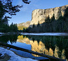 "El Capitan in the early morning, approx 7:15 AM, Feb 14, 2010. I was tightly lined up in a ""tripod row"" with 8 other photographers, most with serious equipment and purpose, capturing this scene on a small spot by the Merced River-one of the few level areas at the waterline which was tripod friendly. Thirty yards to our right, four more photographers were snapping pictures of a relatively mundane frozen pond in which I failed to see the beauty, especially compared to this sight. There was no room next to us anyway! It was 30 degrees. I hope to see the pond postings some day, somewhere. The area was very quiet this early, and the photographers around me moved slowly and spoke softly, as if in reverence of the view."