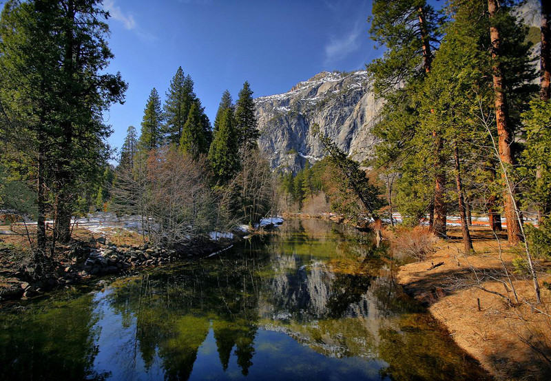 Most people look the opposite direction when they are on this stone bridge over the Merced River, as Half Dome centers the other view with a spectacular and famous scene. This direction, however, is pretty nice too. Early afternoon, February 14, 2010.