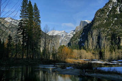 A sharp turn in the Merced River, with Half Dome peeking around in the distance, as seen from the well-groomed riverside trail.  A very short walk is required to get to this spot but, if you keep looking back, this view is visible from the Park exit road.  The afternoon light makes it worth the effort. Mid-afternoon, February 13, 2010.