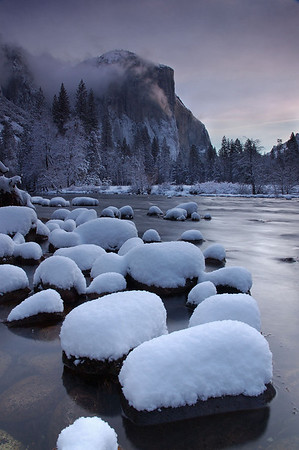 El Capitan's western face hides from the morning light at Yosemite National Park, California