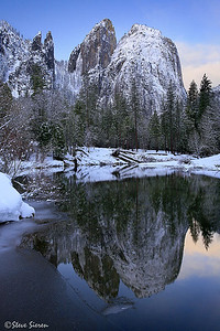 Winter's Cathedral  The Cathedral Rocks and Spires tower over Yosemite Valley and the calm almost glass like Merced River. I got a little lucky to have the sun out at a good moment shortly after some storms came through. Not sure if anyone remembers my last Yosemite post(3 Brothers II) but this was shot 180 degrees from where the camera was pointed on the same morning.