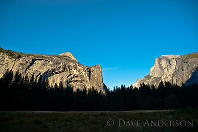 "Scouting locations in Yosemite, the idea being to gain familiarity with the park, times of day to get certain shots, etc.  This is ""Royal Arches"", ""Northte Dome"", and ""Washington Column"" on the left, Half Dome on the right."