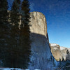This is an inverted reflection of El Cap.  The rocks that you see in the sky are from the river.