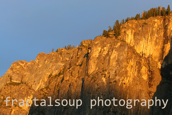 Yosemite mountain reflects golden sunset light in spring