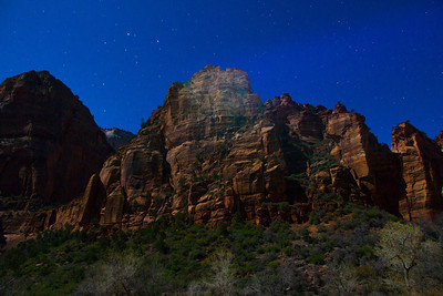 Night time exposure with a hand held spotlight on the peak of the nearby mountain. Zion National Park at midnight.