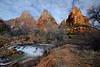 Small waterfall along the Virgin River in Zion National Park with the Court of the Patriarchs in the distance.