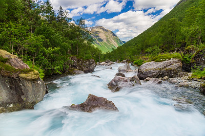Flowing rapid stream at norwegian mountains