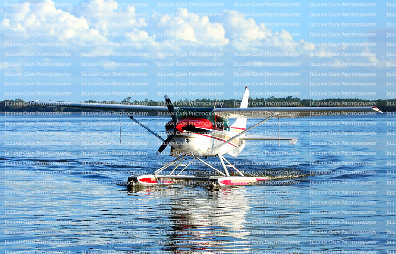 Single engine seaplane turns and prepares to stop at Wooten Park, Tavares, Florida.