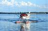 Single engine seaplane turns and prepares to stop at Wooten Park, Tavares, Florida.