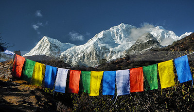 A26:The sister peaks of Mt Khangchendzonda (Rathong and  Kabru group) while walking to Dzongri on the Goecha la trek,with the ubiquitous prayer flags in the foreground.