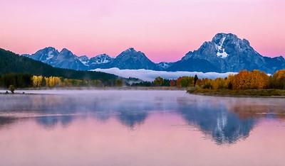 Beautiful alpenglow in the Teton mountain range at dawn.