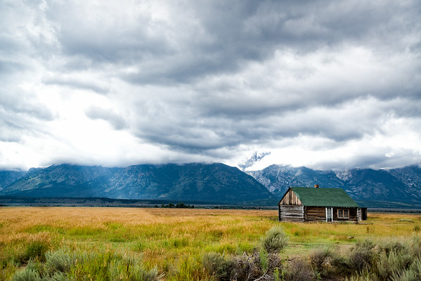 Sept 4 - Old Homestead on Mormon Row, Jackson Hole, Wyoming<br /> <br /> Another image on Mormon Row where the cloud cover  was much lower than the tops of the Tetons.  The sun started to shine through a hole in the thick cloud coverage, but not for very long.  It was raining shortly after I started taking some pictures.<br /> <br /> Thanks so much for your kind comments on the image I posted yesterday from this same area.  I hope you won't get bored with these images as I have some more I am going to post.  Thanks again!