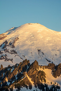 The glaciers on Mount Rainier glow in the morning light.
