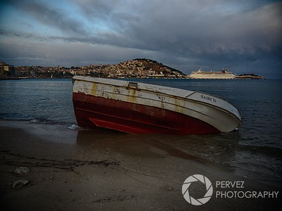 A boat left in the water at sunrise in Kusadasi, Turkey. In the morning (following a pretty epic day in Ephesus and eating dinner while photographing a beautiful sunset), my college roommate and I got up pretty early and headed out to the beach to shoot some photos as the sun came up. While the sunrise itself wasn't spectacular, given the angle, I did manage to get a handful of cool shots of old boats in the water, like this one.