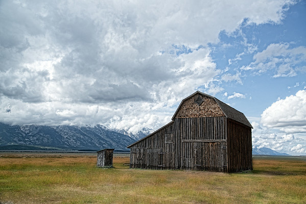 Sept 3 - Barn and outhouse under a cloudy sky<br /> <br /> I took this image on Mormon row outside of Jackson hole, Wyoming.  The peaks of the Tetons were not visible due to a low cloudy sky.  I will be posting other images I took in the area.<br /> <br /> Thank you for your nice comments on the image I posted yesterday, In My Sister's Garden!  They are always much appreciated.