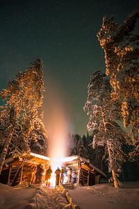 Campfire outside a cabin in Finland