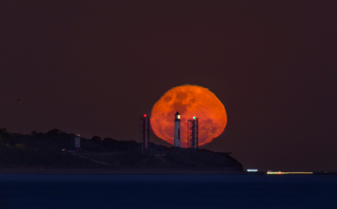 Full Moon silhouette Qcliff lighthouse