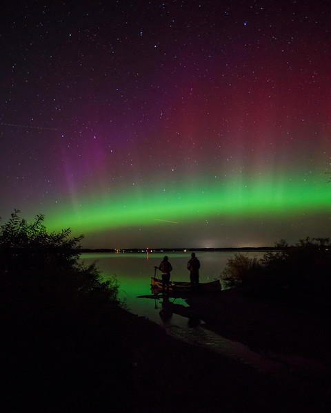 Just as the Aurora was getting stronger a couple in a canoe arrived with flashlights and all.  Rather than feel sorry for my predicament I invited them to pose in the shot.  