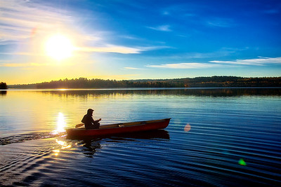 Lyle taking the canoe out at sunrise