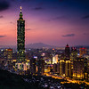 Taipei 101 (Taipei, Taiwan) at dusk.  This 508 meters tall monstrosity houses 101 floors of offices and stores. Ranked the tallest building in the world from 2004 to 2010,  it sticks out like sore thumb in the middle of Taipei.