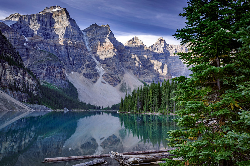 Moraine Lake at sunrise.  Moraine Lake is a glacially fed lake in Banff National Park, 14 kilometres outside the Village of Lake Louise, Alberta, Canada. It is situated in the Valley of the Ten Peaks.