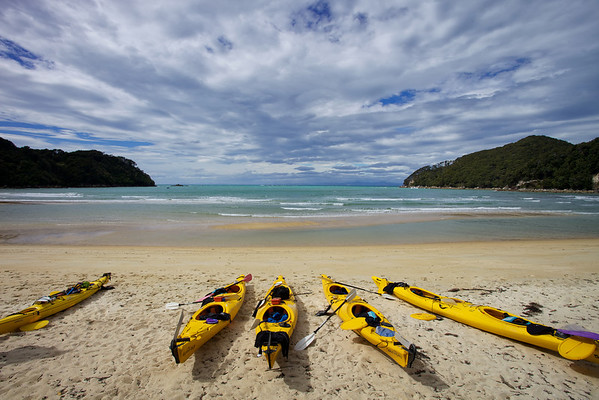 Kayaks drawn up on Bark Bay in Abel Tasman National Park
