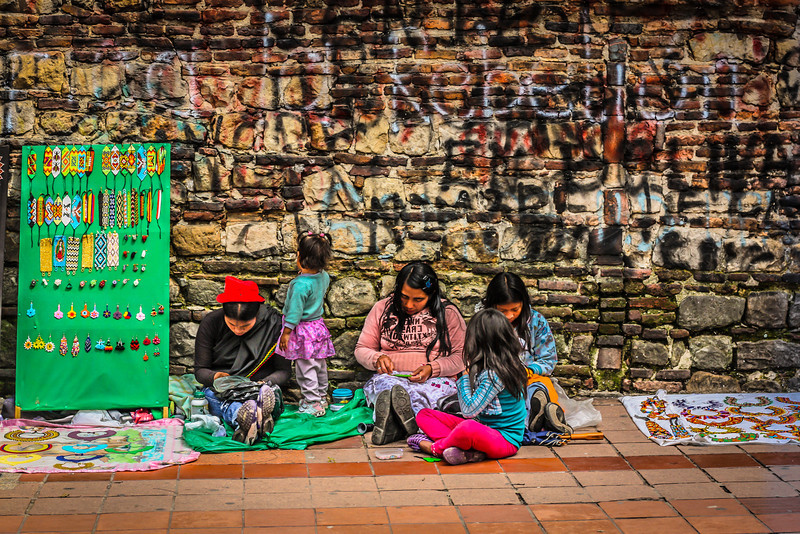 A family with their wares in Bogota.