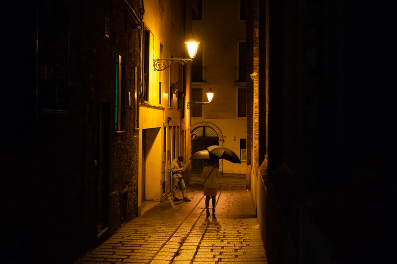 Woman in a Rainy Alley