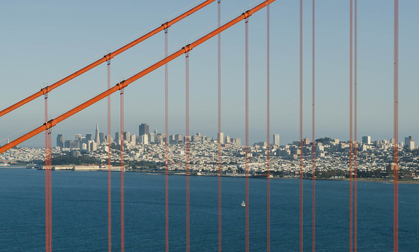 San Francisco skyline through the spans of the Golden Gate Bridge