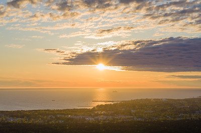 Sunset over Tallinn city and Baltic sea, aerial view