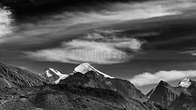 A11:Manerang Peak,Spiti,Himachal Pradesh rises amongst the clouds,as seen from Dhankar.