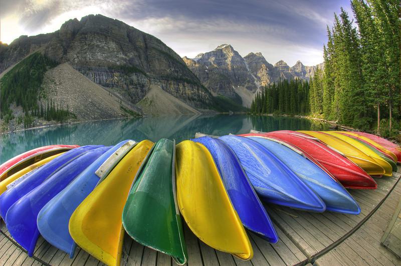 Colorful Canoes at Sunrise on Moraine Lake, Alberta, Canada