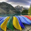 Colorful Canoes at Sunrise on Moraine Lake, Alberta, Canada